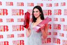 Dua Lipa with her awards for Best British Female Solo Artist and Breakthrough Act at the Brit Awards (Ian West/PA)