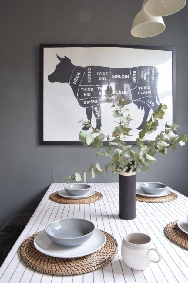 Somerset County Gazette: FEATURE: Dark grey feature wall - the perfect contrast to a white tablecloth and china (Topology/PA). Picture: Topology/PA Photo/Handout