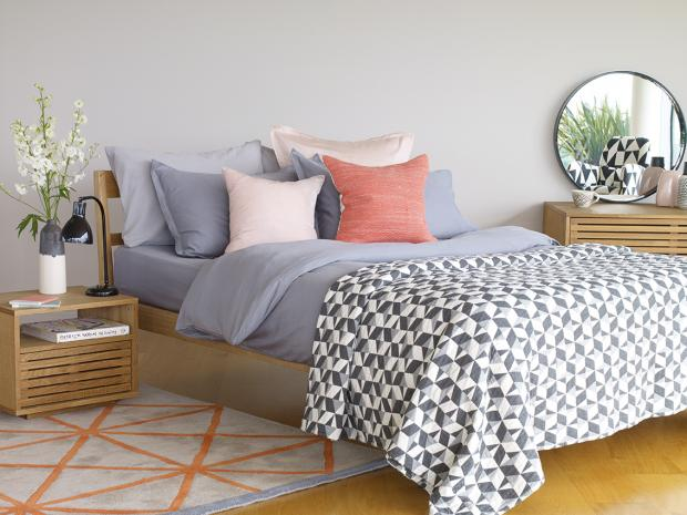 Somerset County Gazette: MIRROR: A reflection in a mirror adds another dimension in a bedroom and also reflects light. Tatsuma bed frame £375; Max Bedside table,£180; ride Rug, £350; Washed Grey Sateen Cover set, £90; Paulista bed set, £150; Nixon Cushion, £25, Habitat. Pic