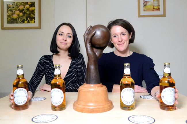 UP FOR THE CUP: Georgia Simpson and Susie Hodgkin, from the Taunton Cider Company, with the skittles trophy.
