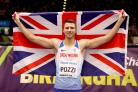 Andrew Pozzi celebrates victory in the 60m hurdles at the World Indoor Championships. (Martin Rickett/PA)