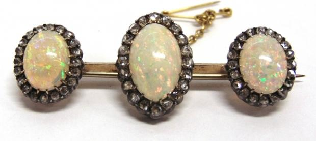 Somerset County Gazette: BEAUTIFUL BROOCH: A smart opal and diamond triple cluster bar brooch, circa 1900 fetched £1,050