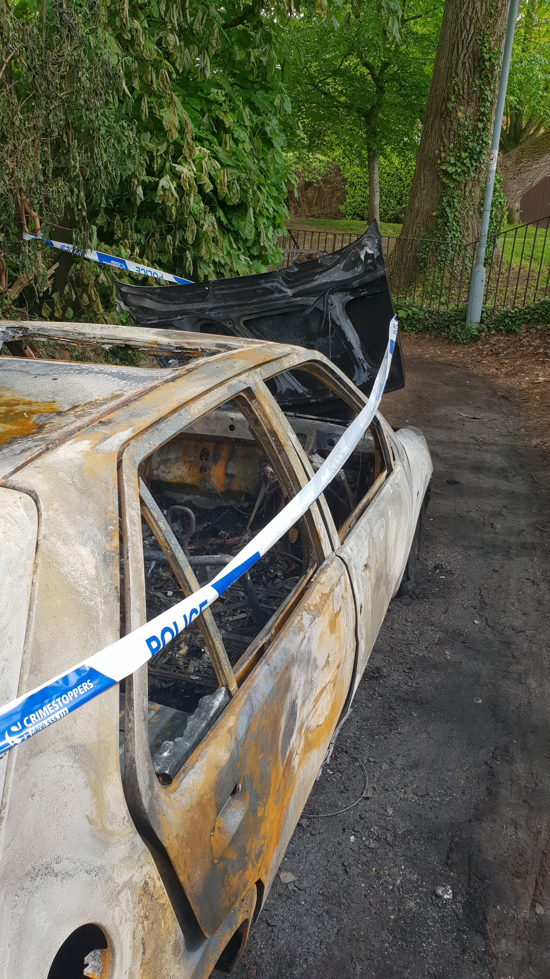 BURNT OUT: The car after the fire in Bishop Fox Road