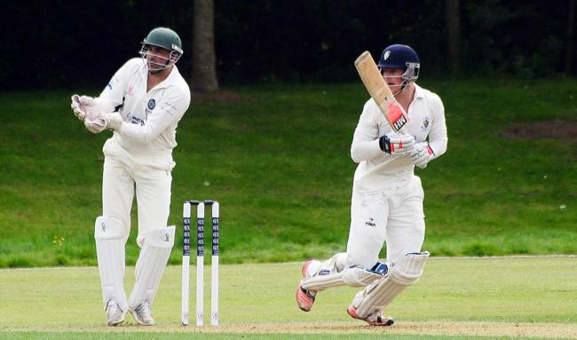 GOOD KNOCK: Sam Shaikh (keeping wicket) made a vital unbeaten 77 for Taunton Deane on Saturday