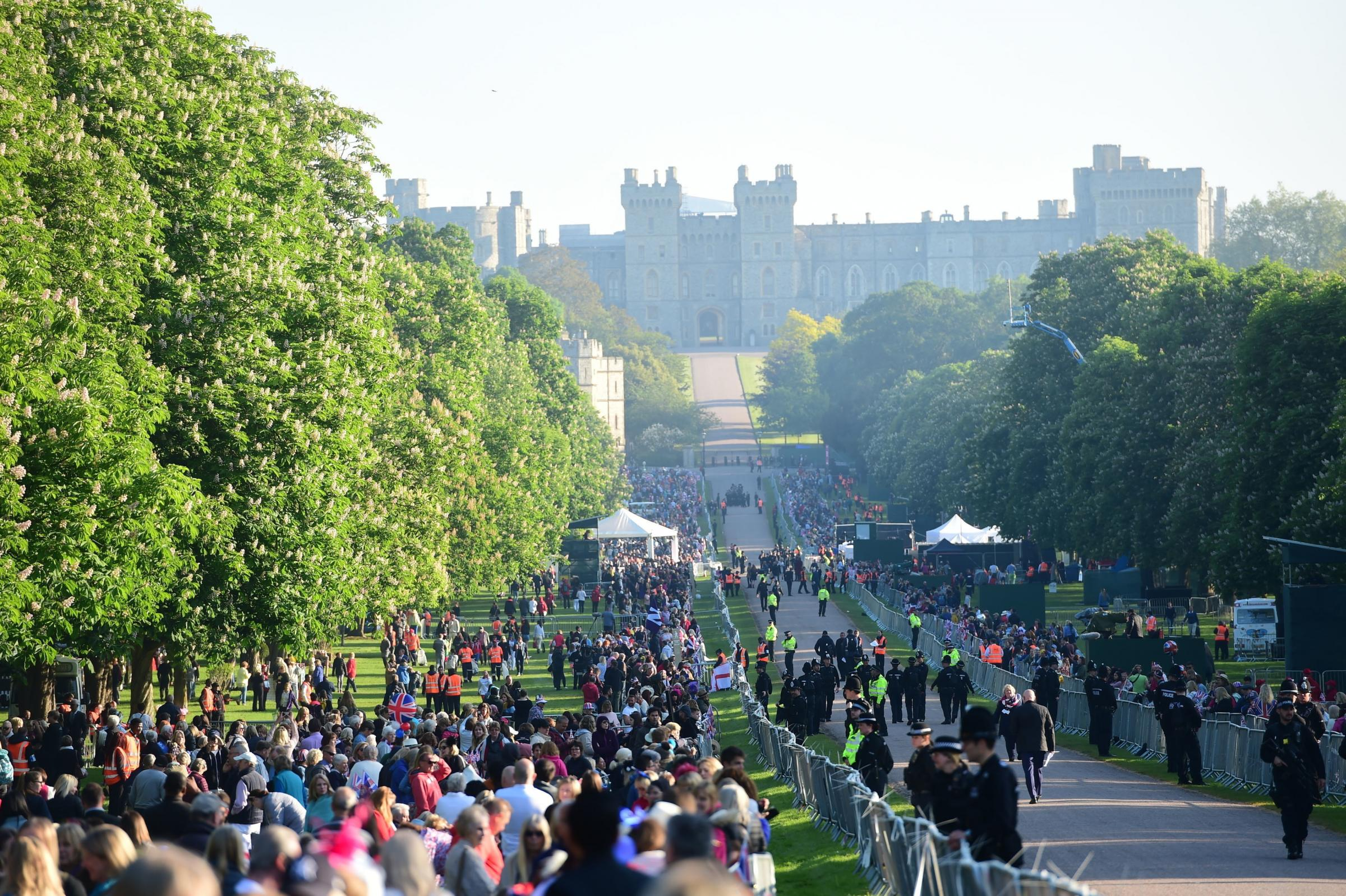 ROYAL WEDDING: Spectators arrive on the Long Walk ahead of the wedding of Prince Harry and Meghan Markle. Credit PA