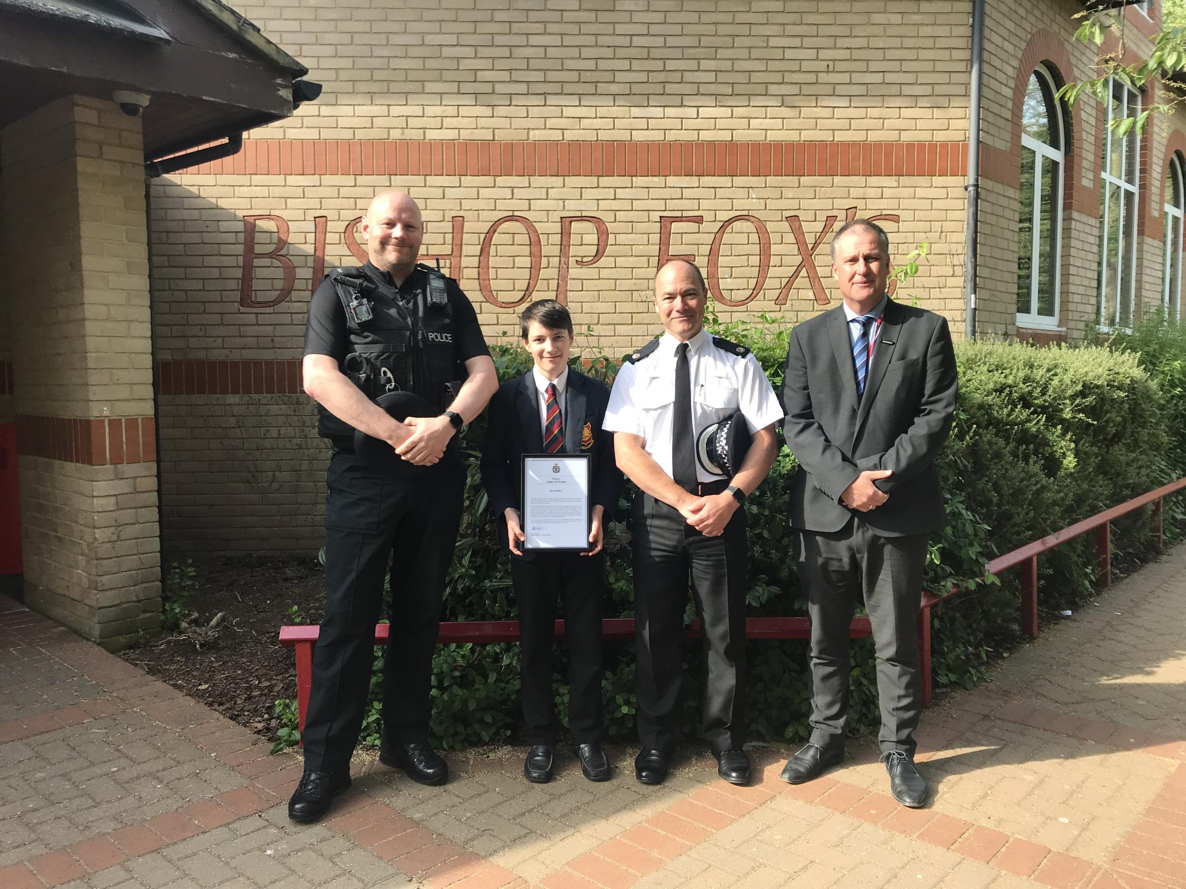 APPRECIATED: Rhys with police officers and the deputy headteacher