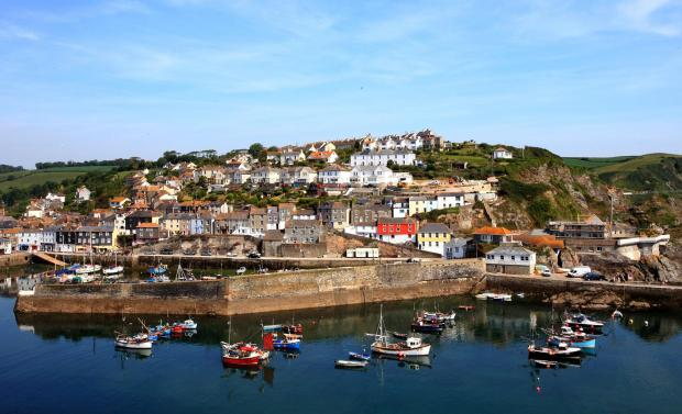 Somerset County Gazette: SECOND HOME BAN: Mevagissey, in Cornwall, where locals who have been priced out of their pretty fishing village have voted to ban second-home owners from buying new builds in a landslide victory. Picture: SWNS