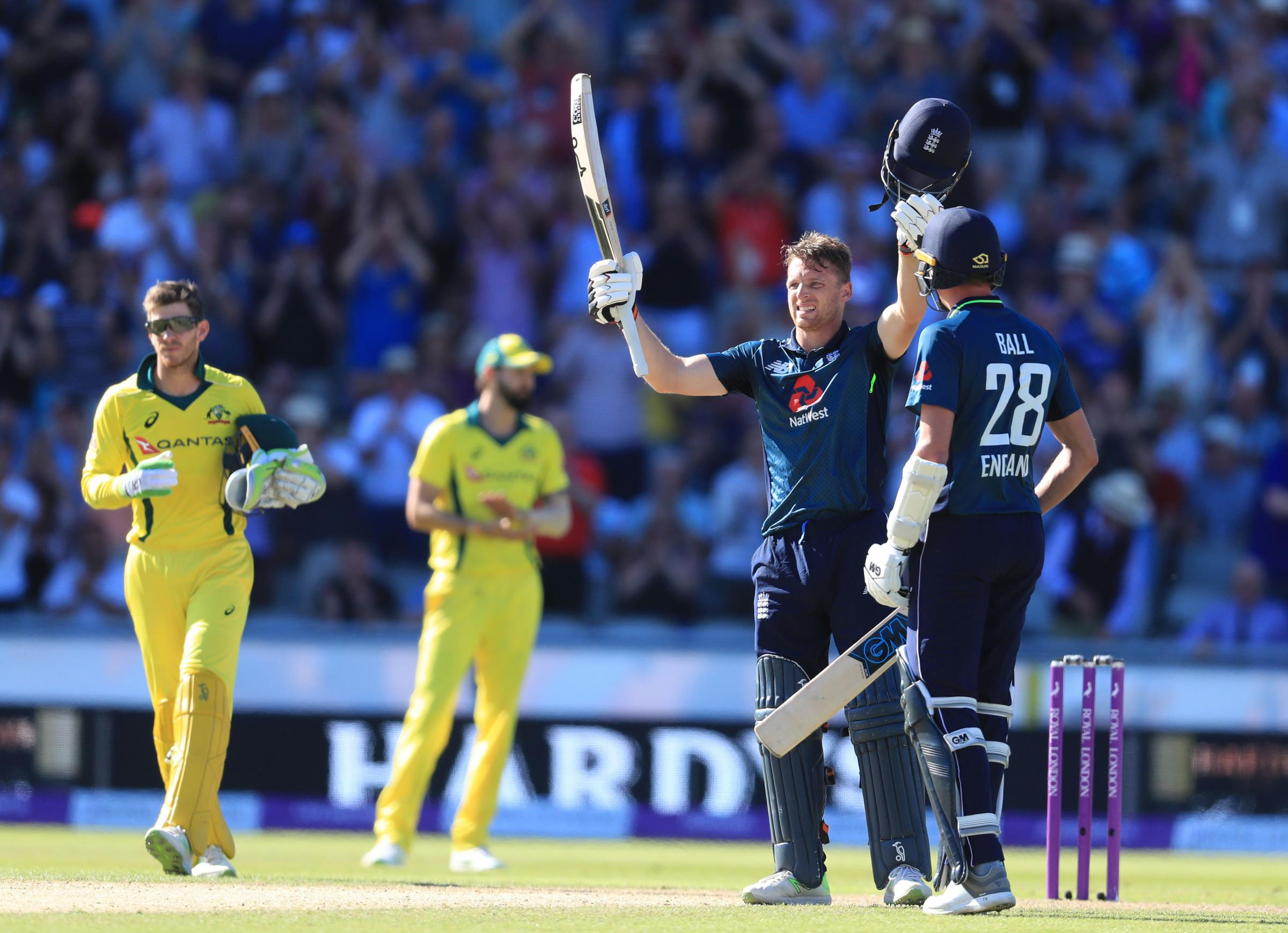 SALUTE: Jos Buttler celebrates his century against Australia at Old Trafford. Pic: PA Wire/Mike Egerton