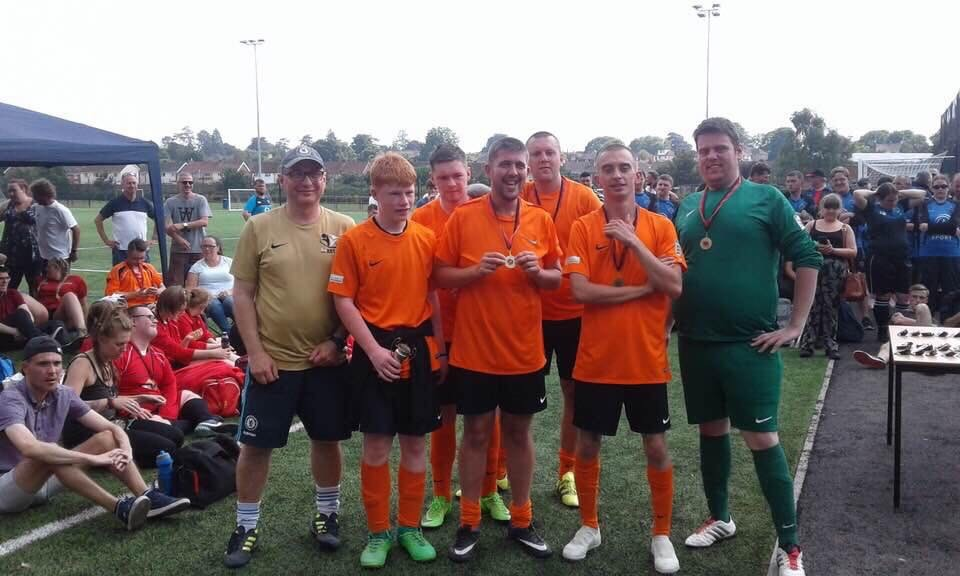 WELLINGTON AFC's disability team (from left): back row - Jason Fox (coach), Charlie Young, Dan Saunders; front row - Alex Gallagher, Bradley White, Jack Mott, Martin Gadd (gk).