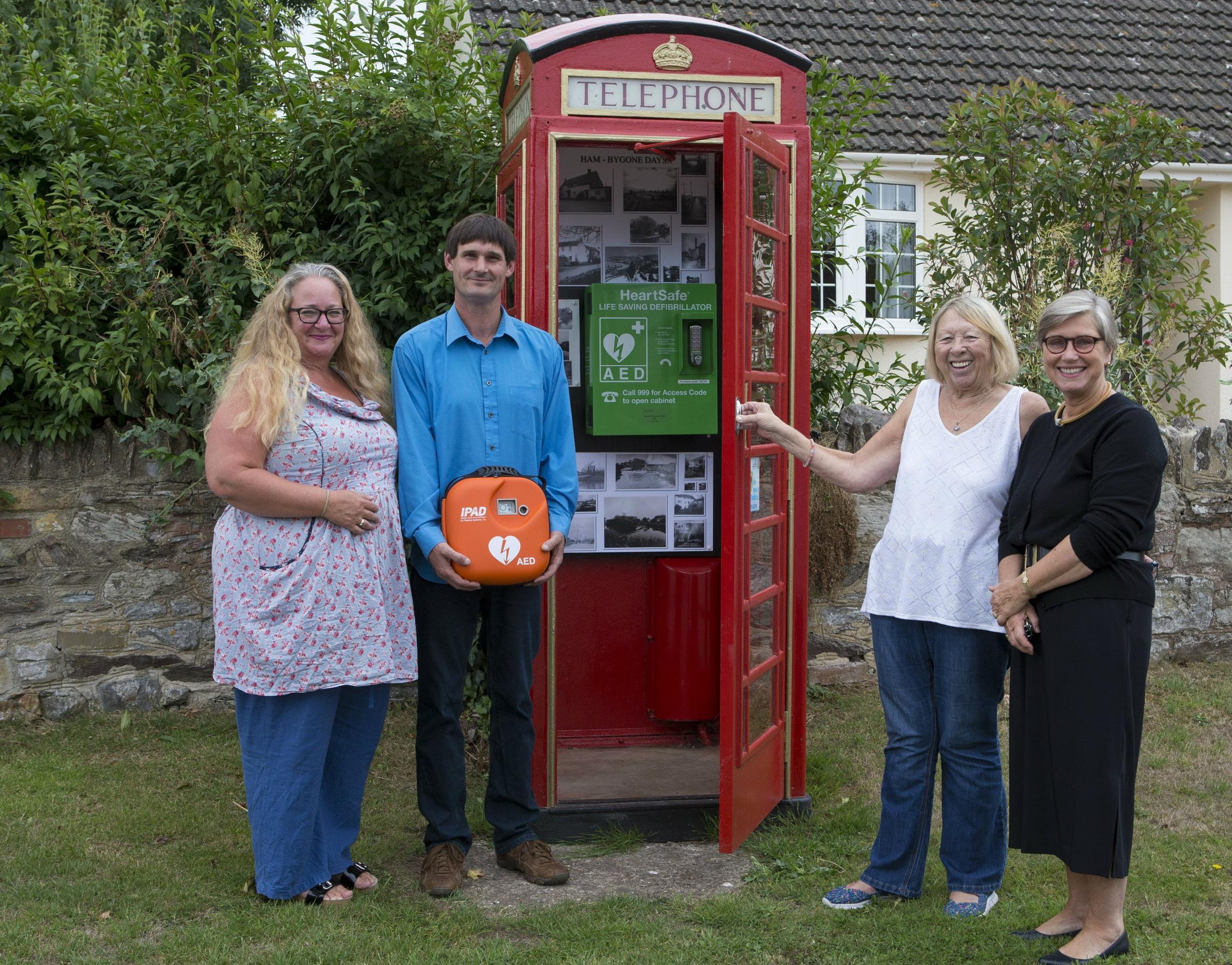 OLD PHONE BOX: Sue Wheeler, of Somerset Community Foundation, Simon Hutchings, Creech St Michael Parish Council chairman, Maggie Machin, volunteer caretaker, and Cllr Jane Warmington, of Taunton Deane Borough Council, with the defibrillator at Ham