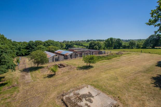 Somerset County Gazette: DUNKESWELL AIRPORT: A collection of Grade II Listed buildings on the only US Naval landbase in Europe during World War Two have been put on the market for £250,000. Picture: SWNS