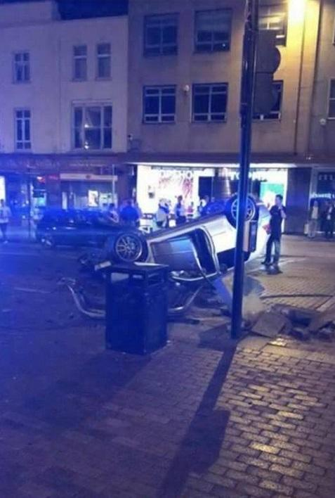 One taken to hospital after car flips in Taunton town centre