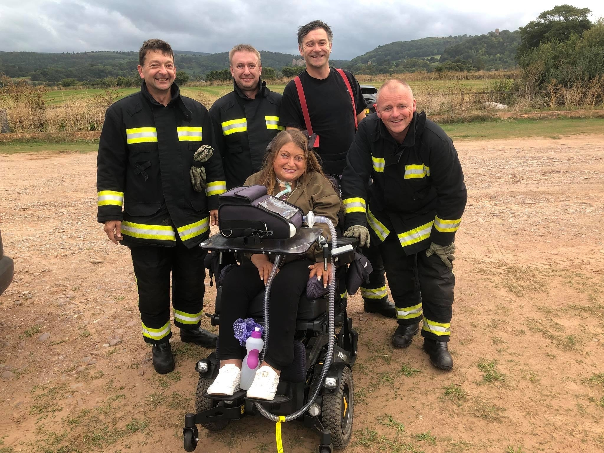 THANKFUL: Hannah Rose, 34, with firefighters from Minehead Fire Station. PIcture - Hannah Rose