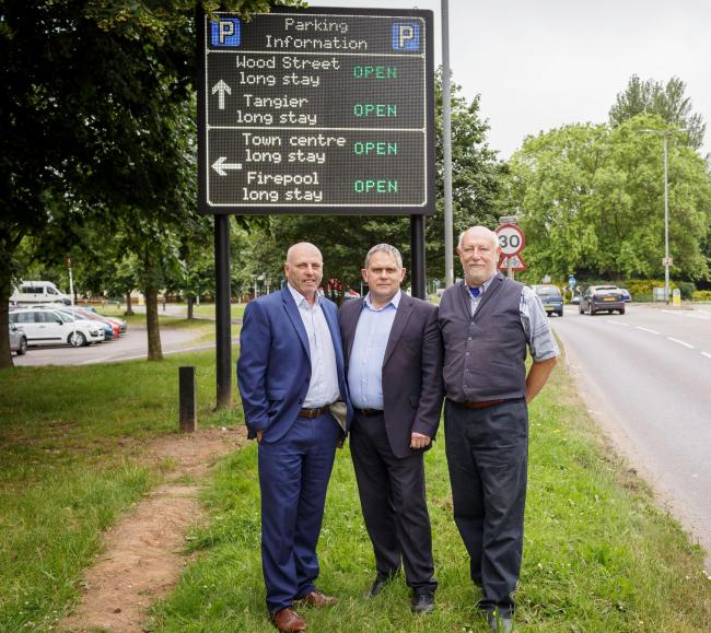 SIGN OF THE TIMES: Somerset County Council's Cllr John Woodman with Taunton Deane's Cllrs Mark Edwards and Roger Habgood at the unnveiling of the signs in June