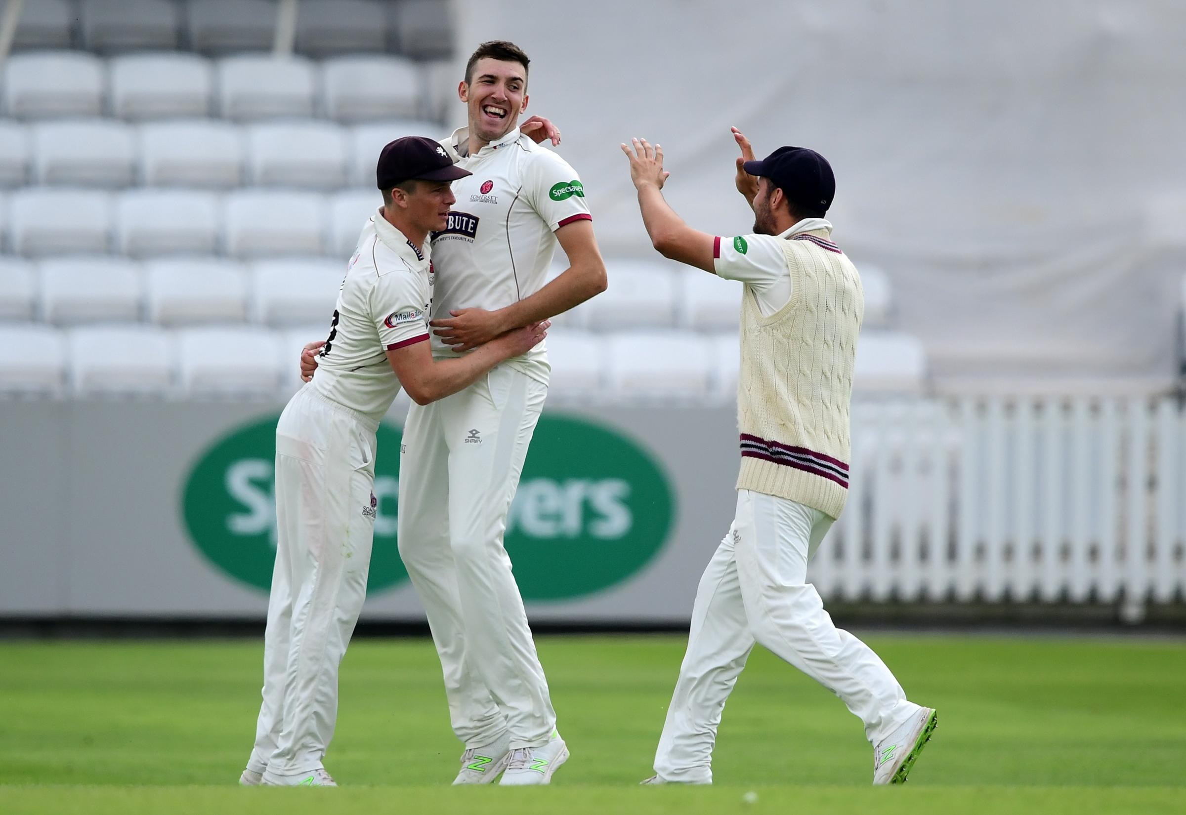 HAT-TRICK: Craig Overton (centre) claimed three wickets in as many balls against Notts - just a day after Tom Abell (left) had done the same. Pic: Alex Davidson/SCCC