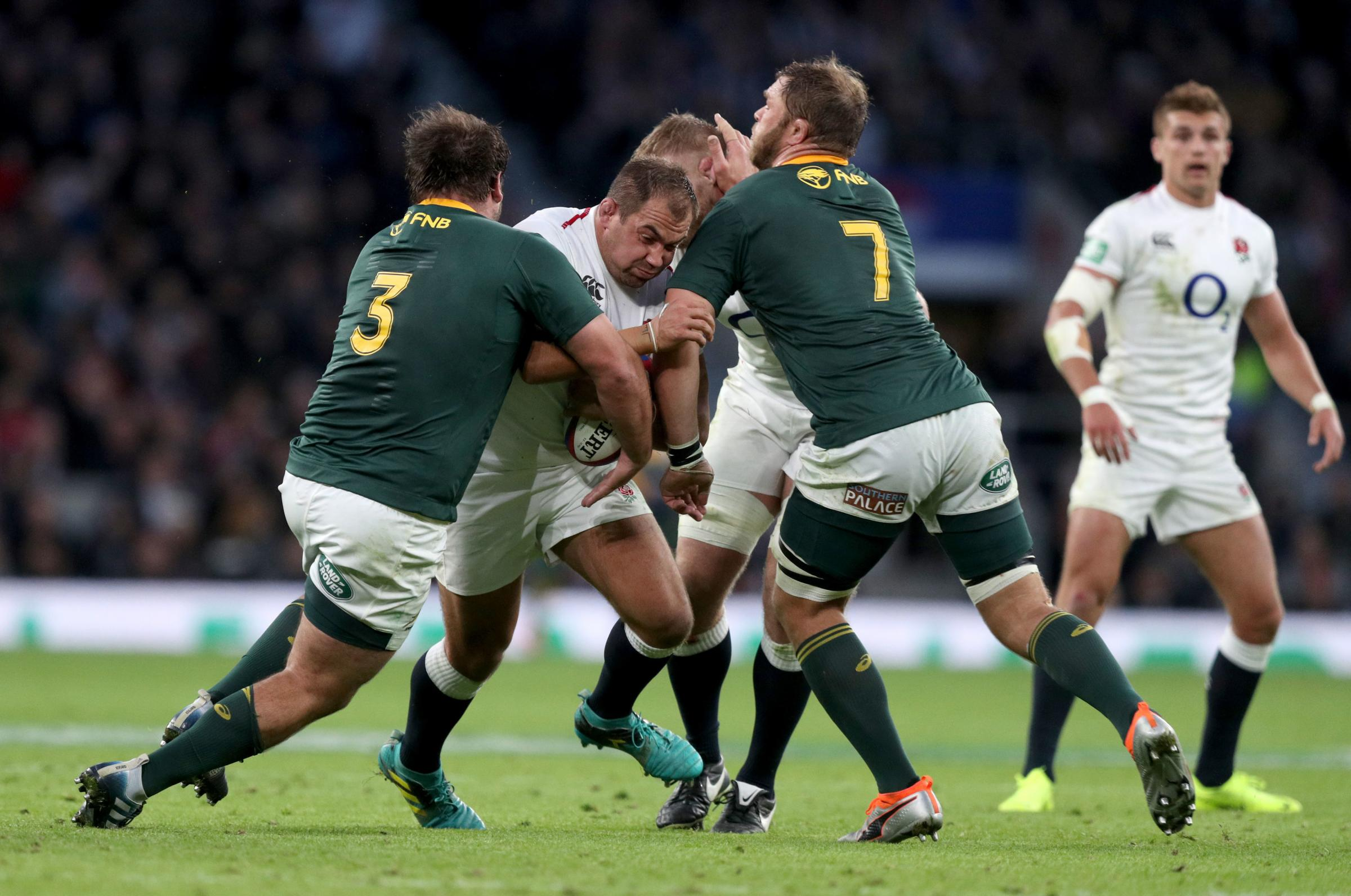 CLASH: England's Ben Moon is tackled by two South Africa players at Twickenham yesterday. Pic: Andrew Matthews/PA Wire
