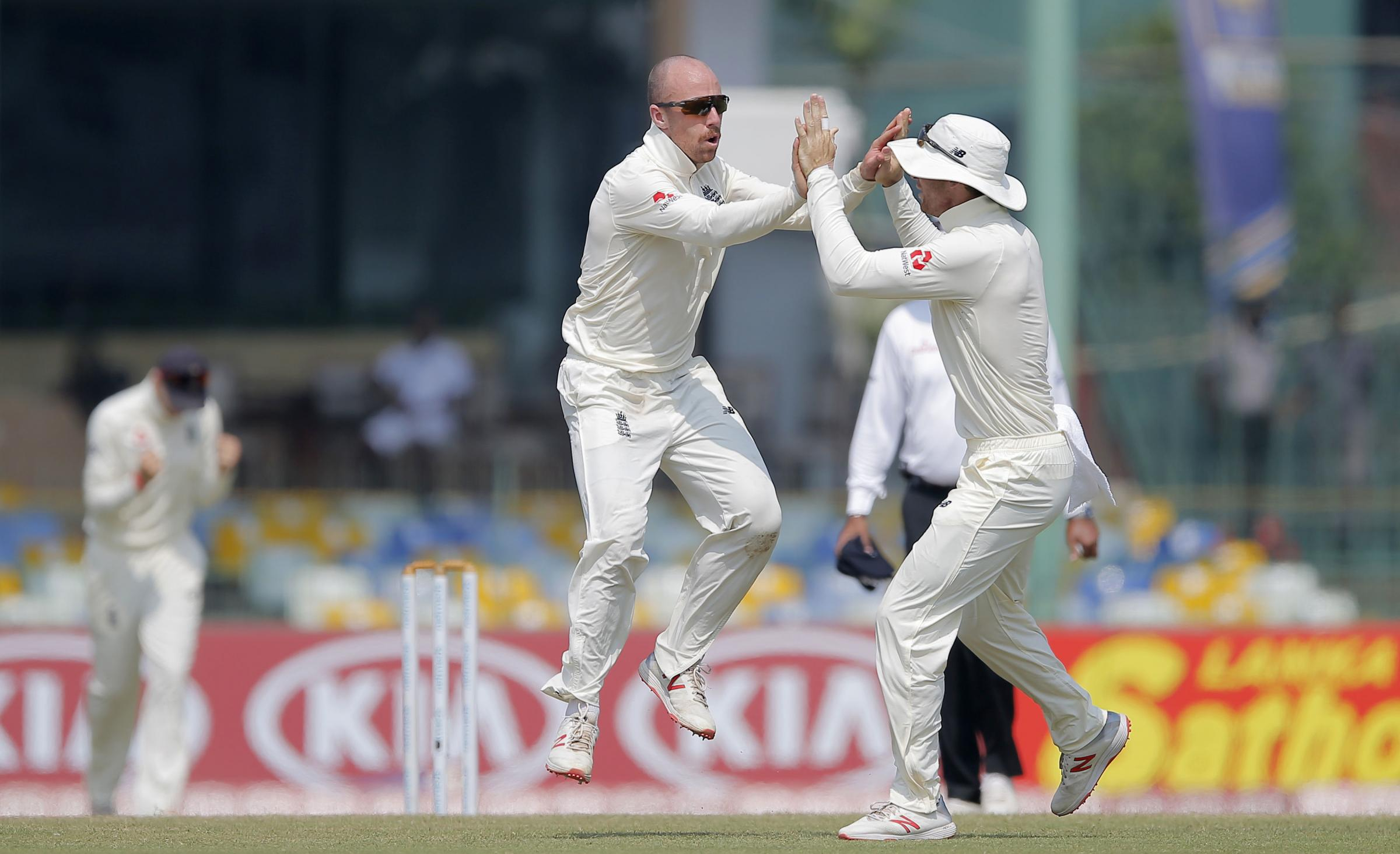 England's Jack Leach, left, celebrates taking the wicket of Sri Lanka's Lakshan Sandakan during the fourth day of the third test cricket match between Sri Lanka and England in Colombo, Sri Lanka, Monday, Nov. 26, 2018. (AP Photo/Eranga Jayawardena
