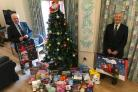 CHRISTMAS GIFTS: Lawrie Hodges and Ray Hall with the toys donated to Children's Hospice South West