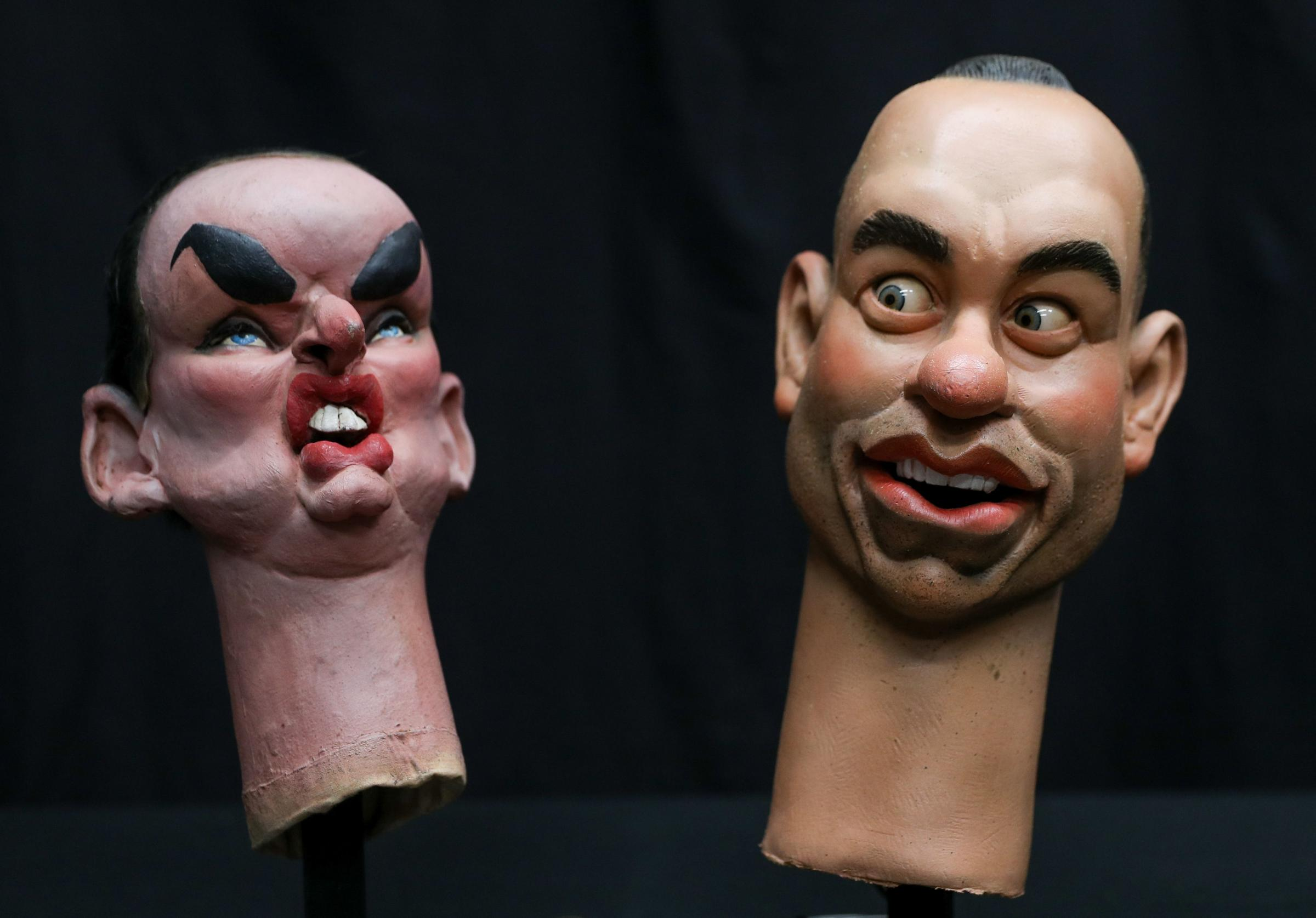 Somerset County Gazette: COMICAL: Spitting Image puppet heads of Tom Hanks (right) and Boy George. Photo: Andrew Matthews/PA Wire
