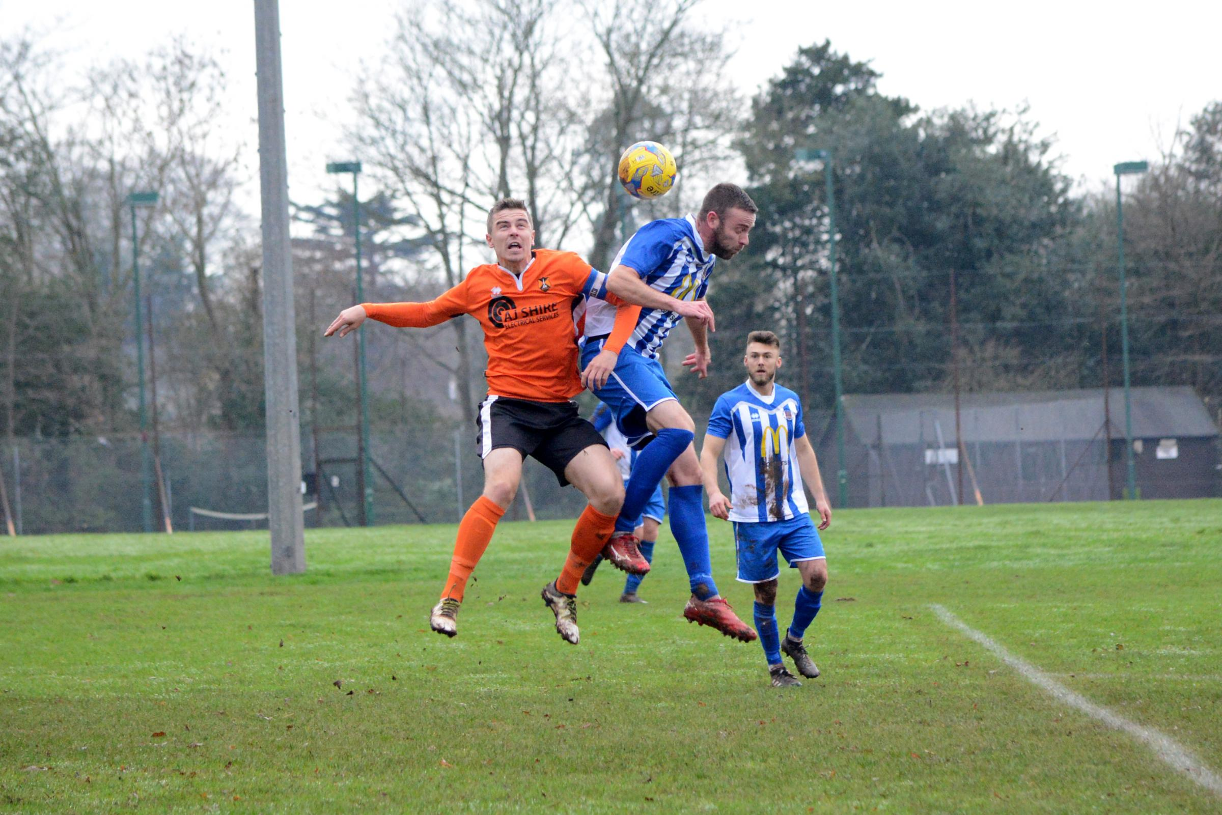 BLOW: Wellington captain Sam Bryant (orange kit) departed with an injury against Brislington. Pic: Aisling Magill