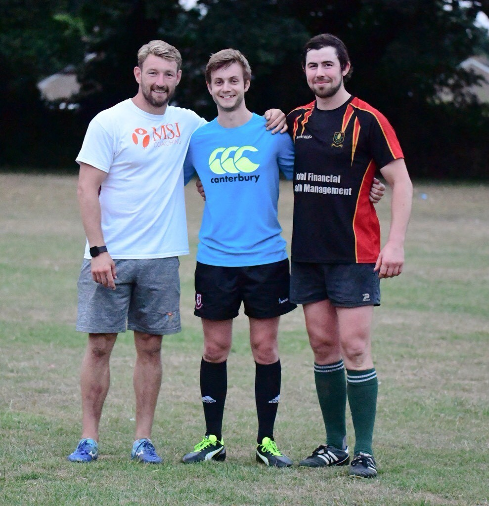 NEW MAN: Matt Jess (left), pictured helping out in pre-season at Chard RFC, has signed for Taunton Titans until the end of the season