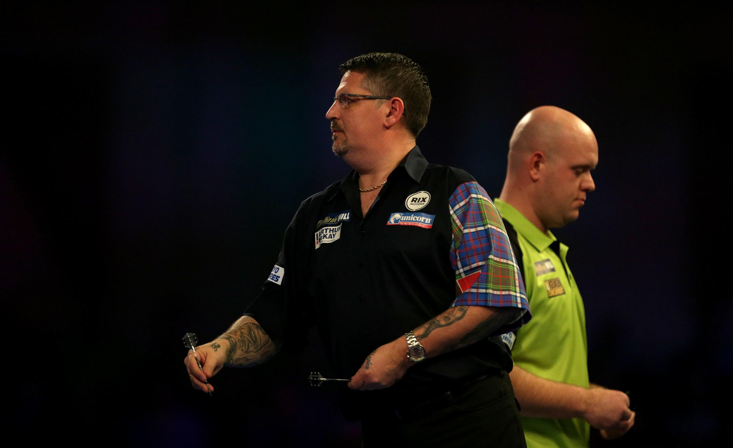 RIVALS: Gary Anderson and Michael van Gerwen are two of the darts stars in Minehead this weekend. Pic: Steven Paston/PA Wire