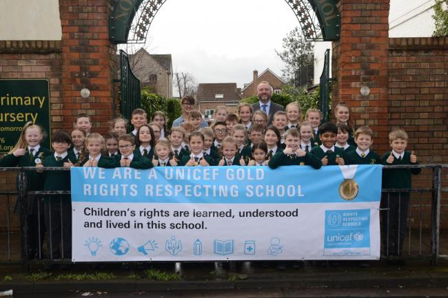 AWARD: Mike Snowden with pupils from North Town Primary School