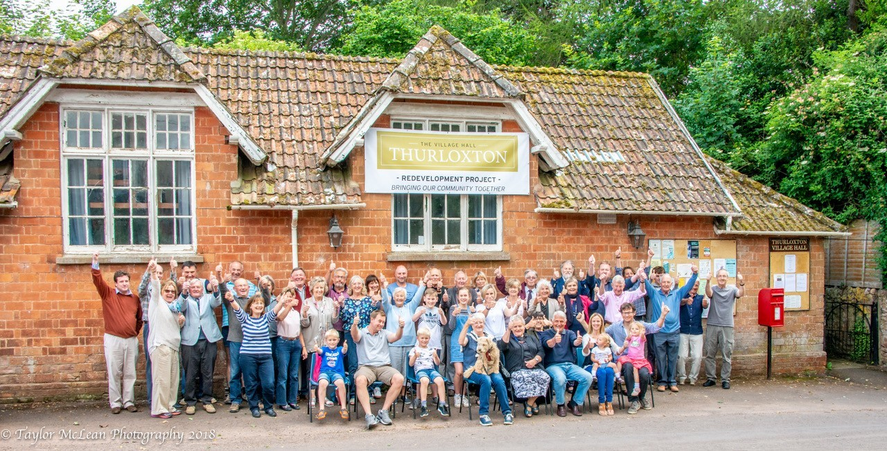 CELEBRATE: Villagers celebrating their plans to refurbish the hall. PIC: Taylor McLean Photography.