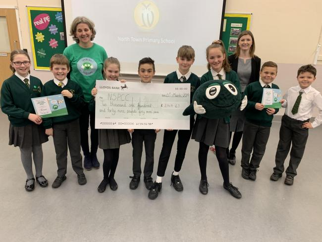 CHARITY: North Town School pupils with the cheque for the NSPCC