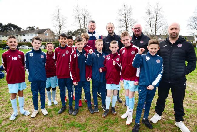 BOOST: Taunton youth players with Damien Brunt (coach), Steve Willis (board of trustees chairman), Kevin Sturmey (Taunton Town chairman) and Rob Dray (Taunton Town head of football)