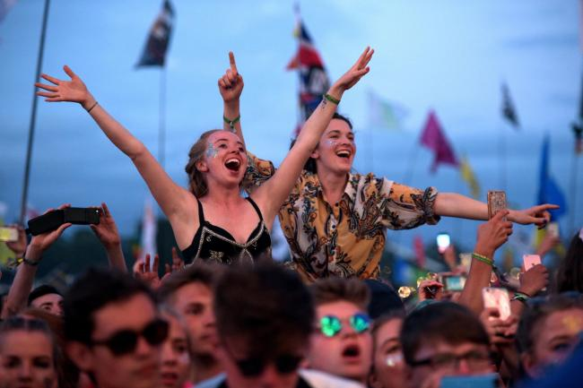 TRIAL: Festival goers at Glastonbury Festival last year. Picture - PA