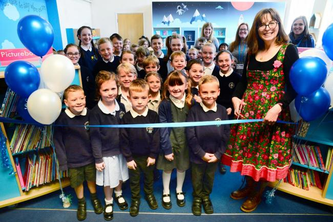 NEW ADDITION: Claire Barker opening the library at the primary school