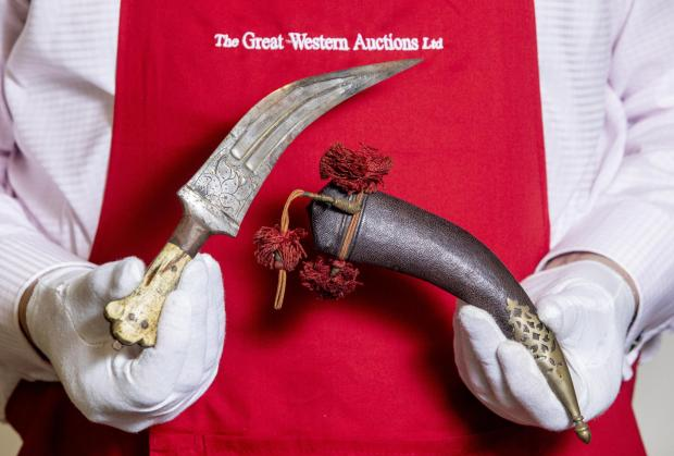 Somerset County Gazette: AUCTION: The Arabian Janbiya dagger with bone handle (estimate: £8,000-10,000) belonging to T.E. Lawrence (Lawrence of Arabia). Picture: SWNS