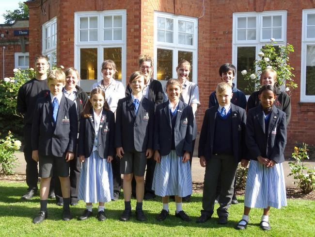 AWARDED: Taunton School cleaning staff with prep school students